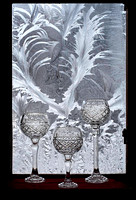 3 goblets in front of a frosted window