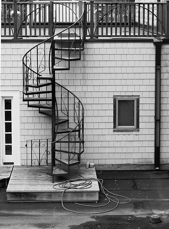 aspiral staircase with a hose